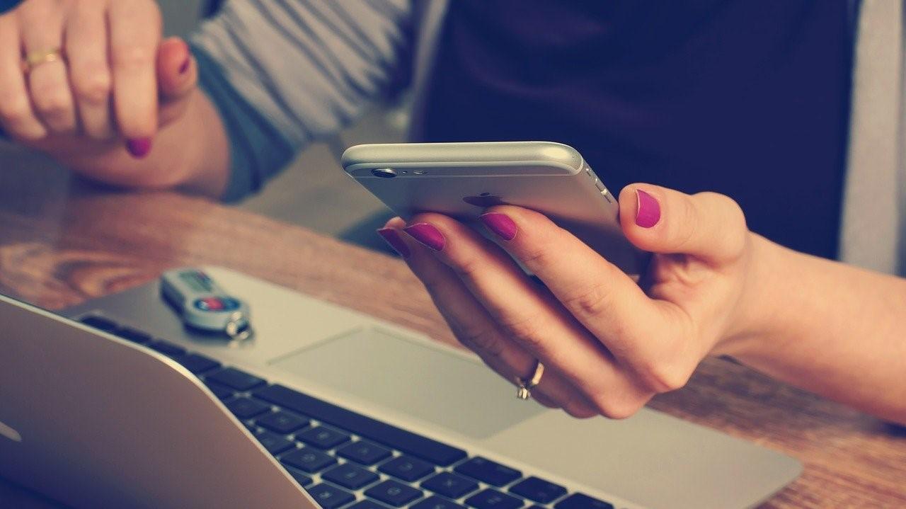 phone laptop woman