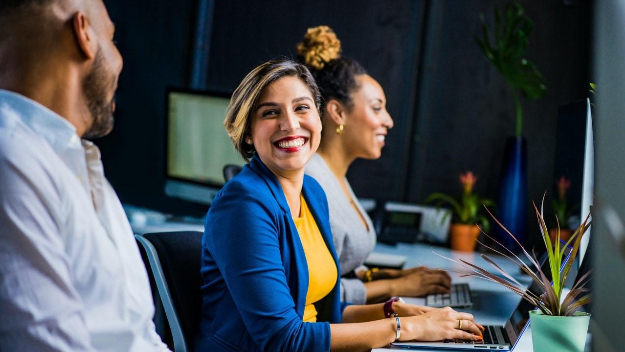 woman smile desk